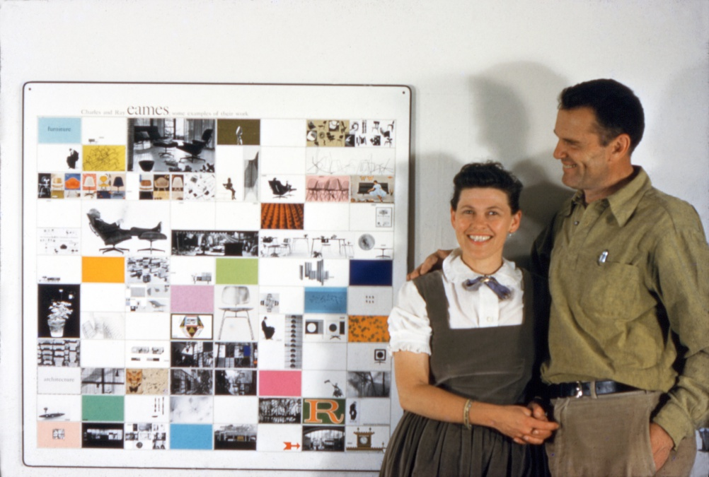 2. The World of Charles and Ray Eames. The couple with a panel of work made for the American Institute of Architects, 1957. © Eames Office LLC