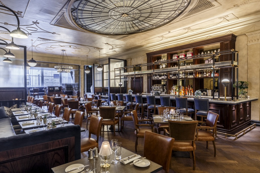 4 - Flooring in the restaurant area is a mix of herringbone dark-stained oak and marble chequerboard tiling