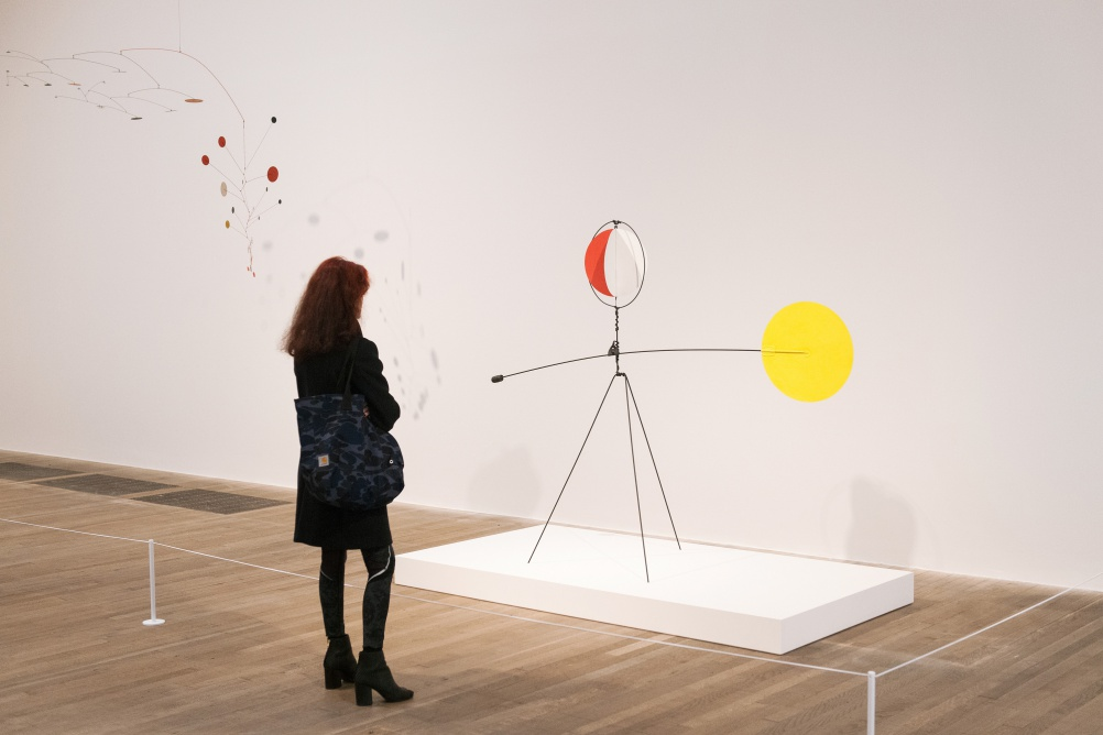 Installation view of Alexander Calder, Gamma, 1947 and Red and Yellow Vane, 1934