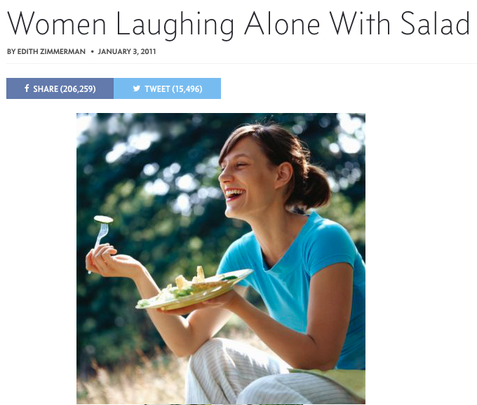women laughing alone with salad stock photography