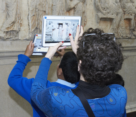 children using british museum's new app in the parthenon gallery