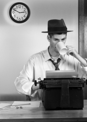 reporter with coffee and typewriter