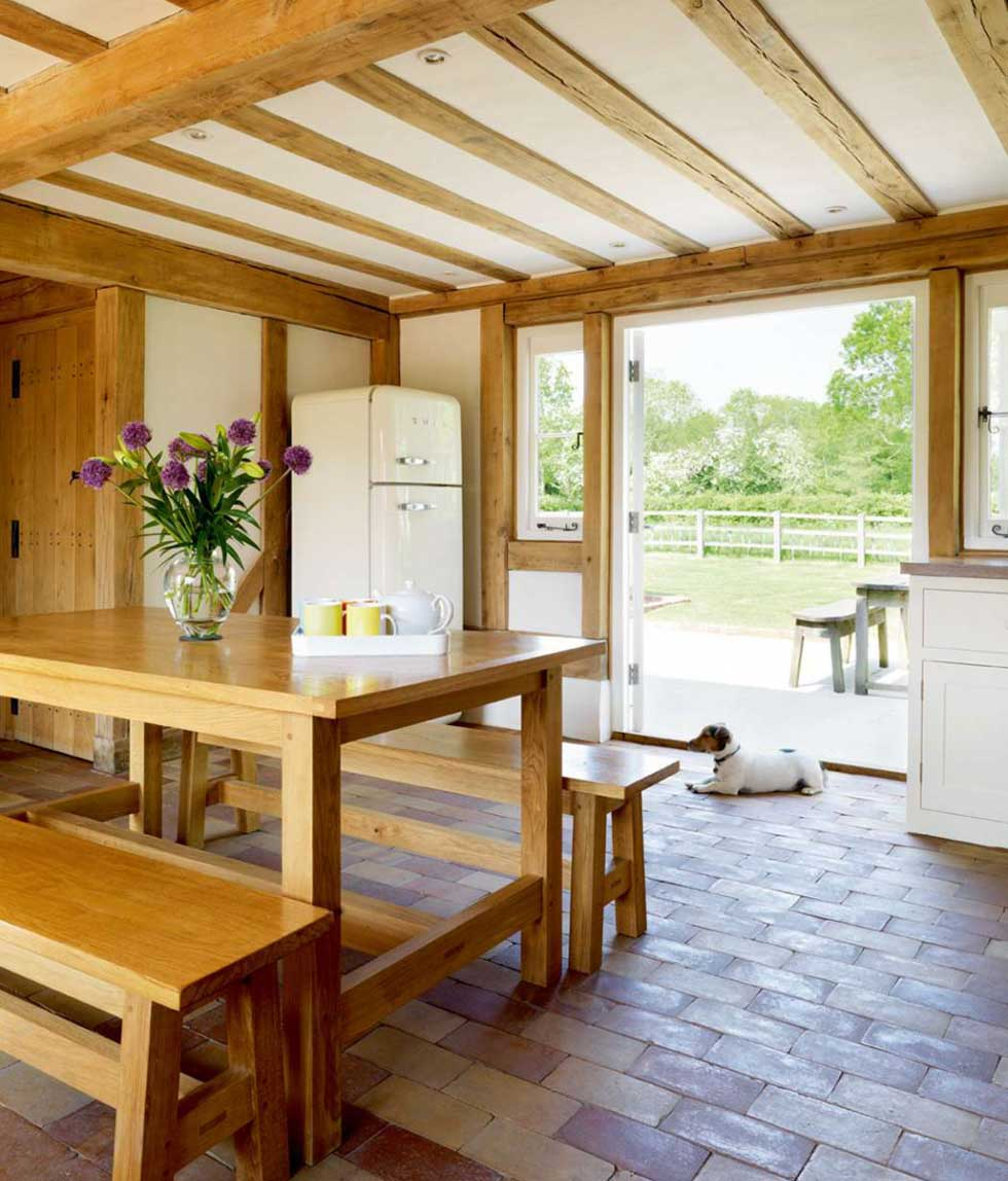 Wood framed glass doors lead from the kitchen out into the garden