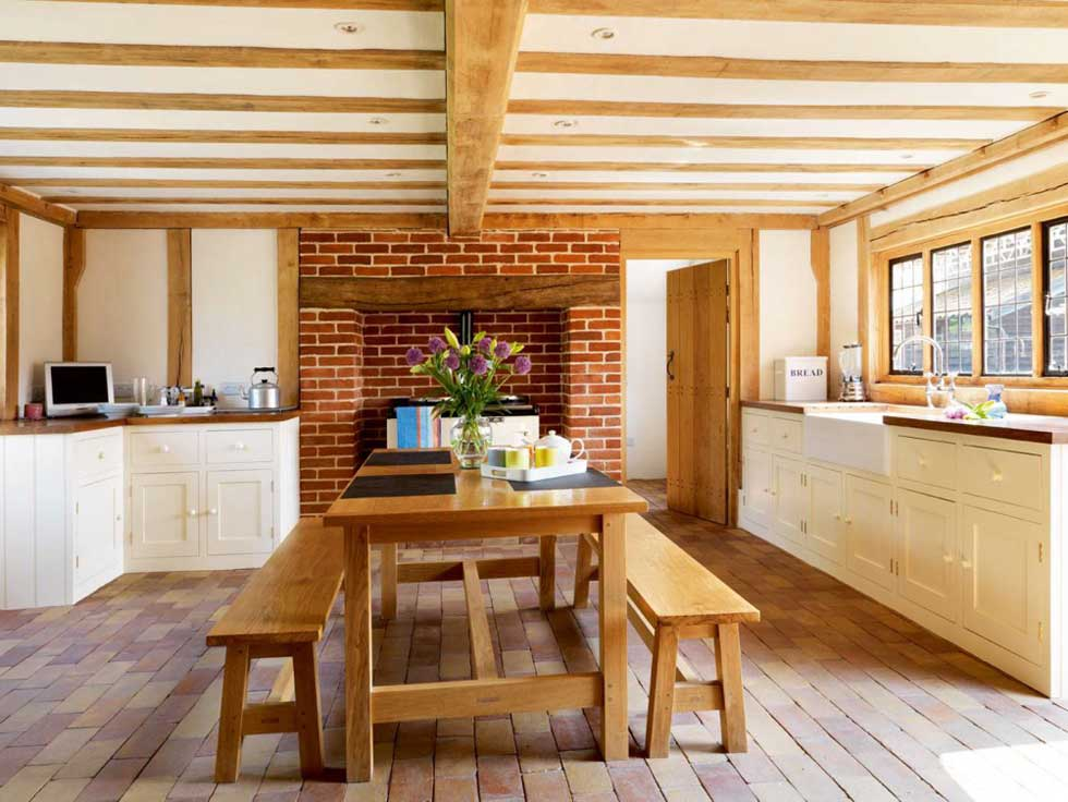 Wooden benches and table in the dining area of the kitchen