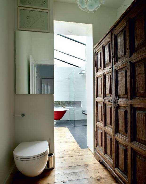 The bathroom includes built-in cupboards