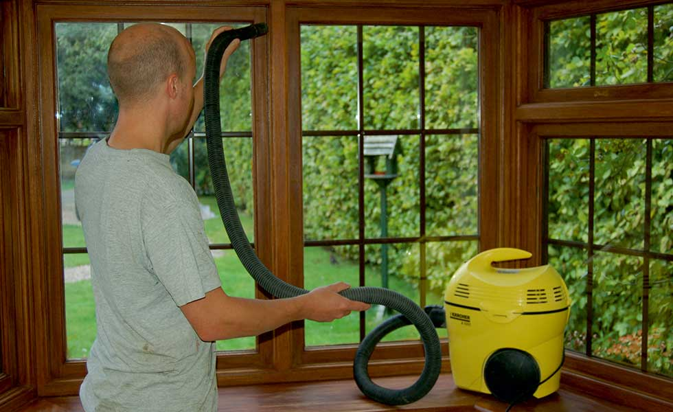vacuum cleaning around the window frame