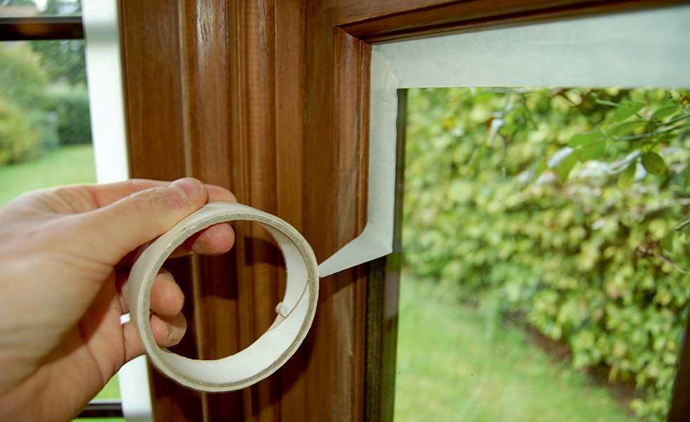masking tape round windows