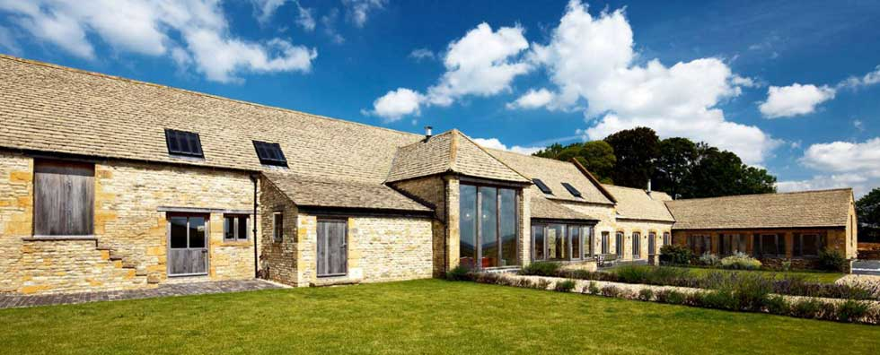 A converted stone barn with large aspect glazing