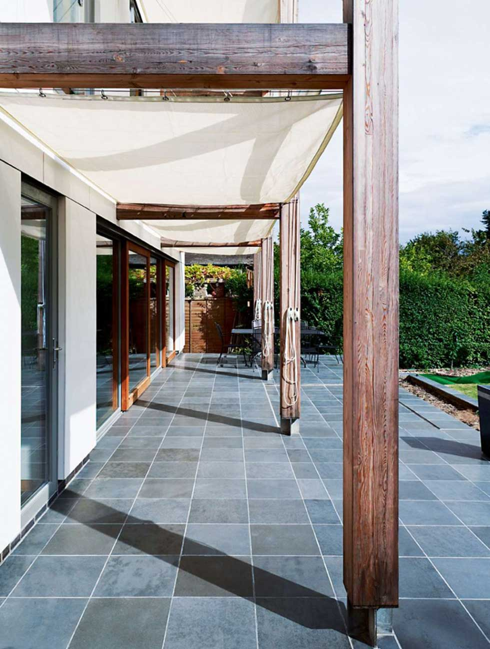 Ceramic slate-look tiles continue out onto the patio and absorb the sun's heat