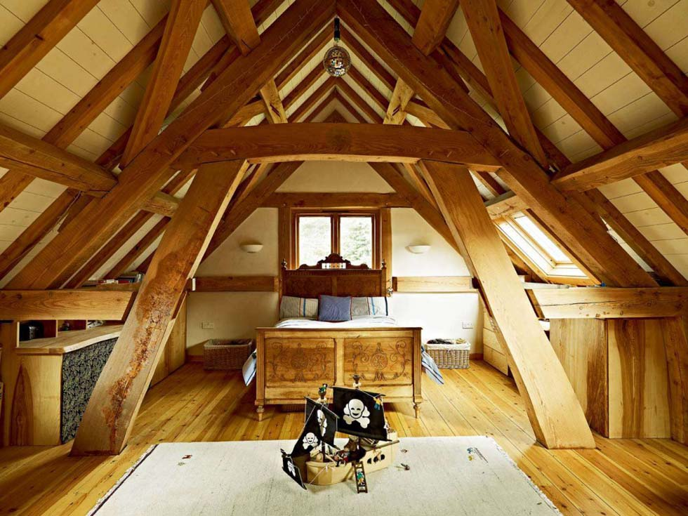 Loft bedroom in an oak frame house