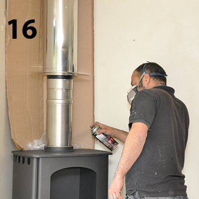 spraying the flue to match the stove