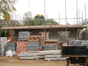 building the superstructure of a home with scaffold in place