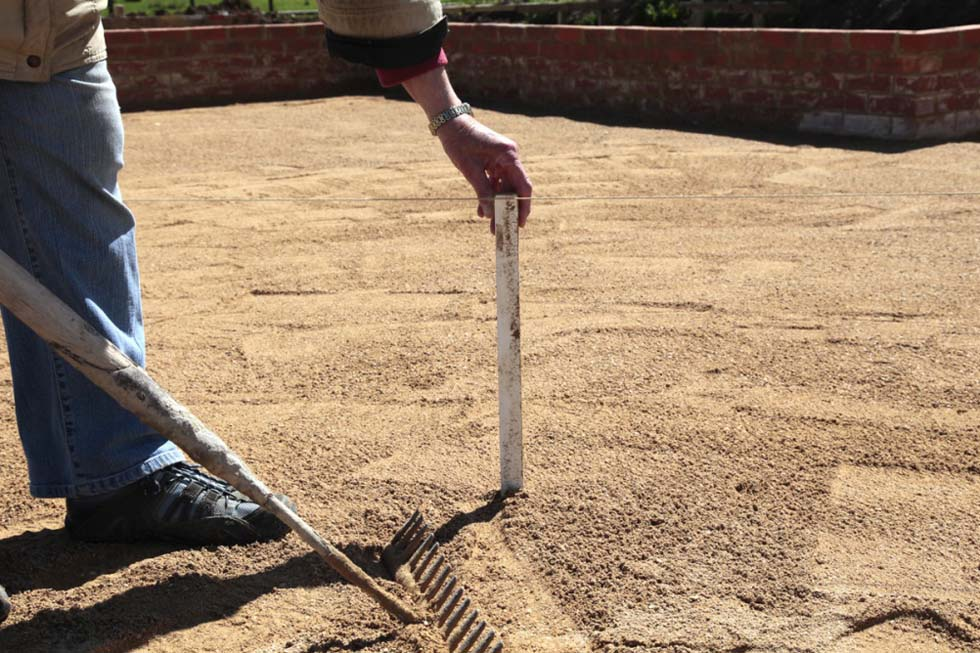 Sand is built up to about 30mm to allow for compaction...
