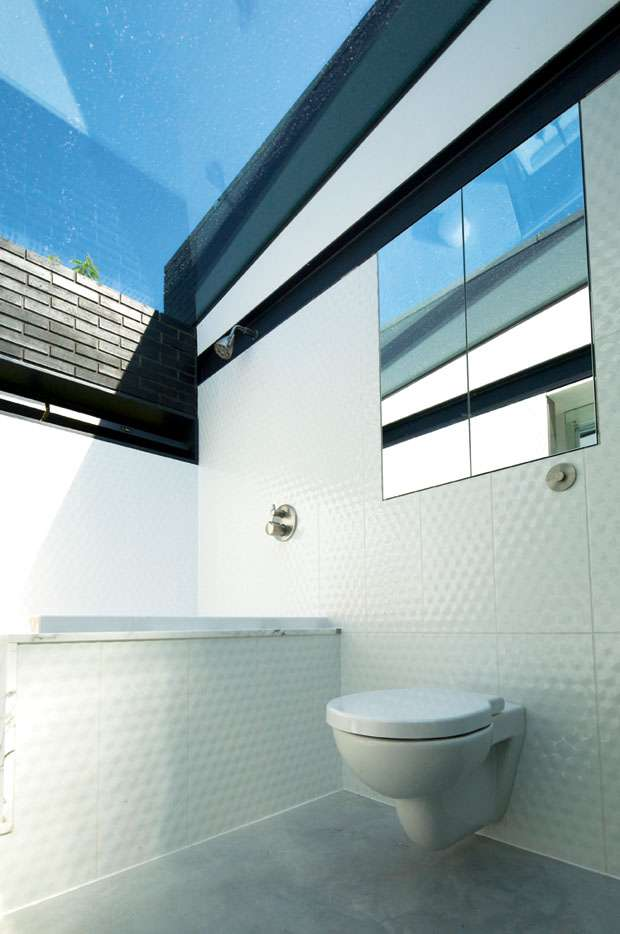 view to sky outside from urban self build bathroom