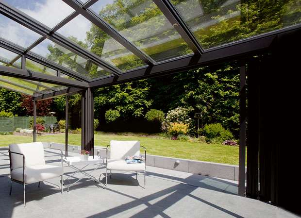 glazed roof on a sunroom leading to a garden