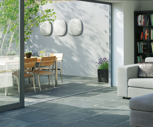 Using the same flooring throughout softens the threshold