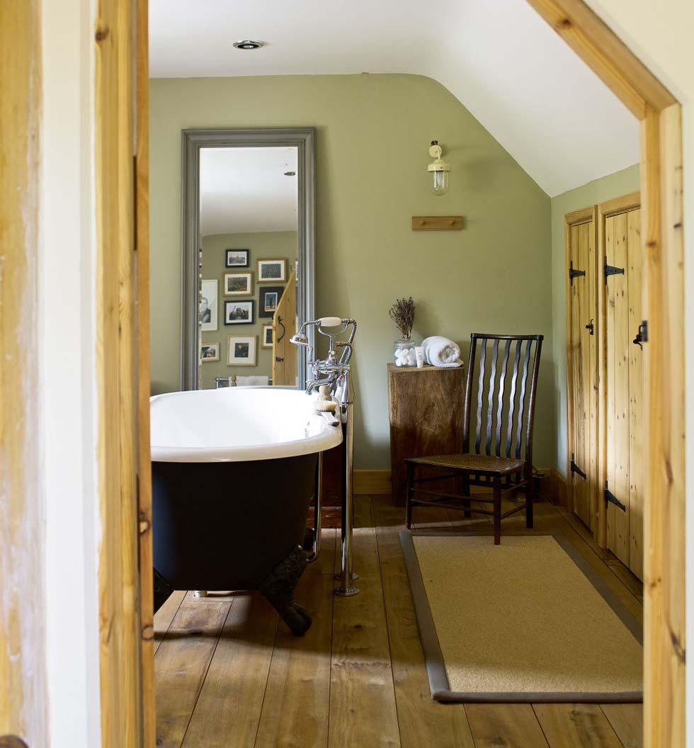 The bathroom with freestanding bath