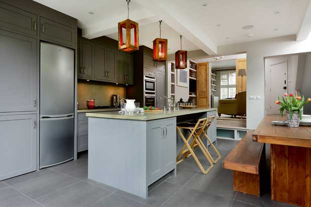 bespoke light fittings were made by the designer owner in this grey kitchen