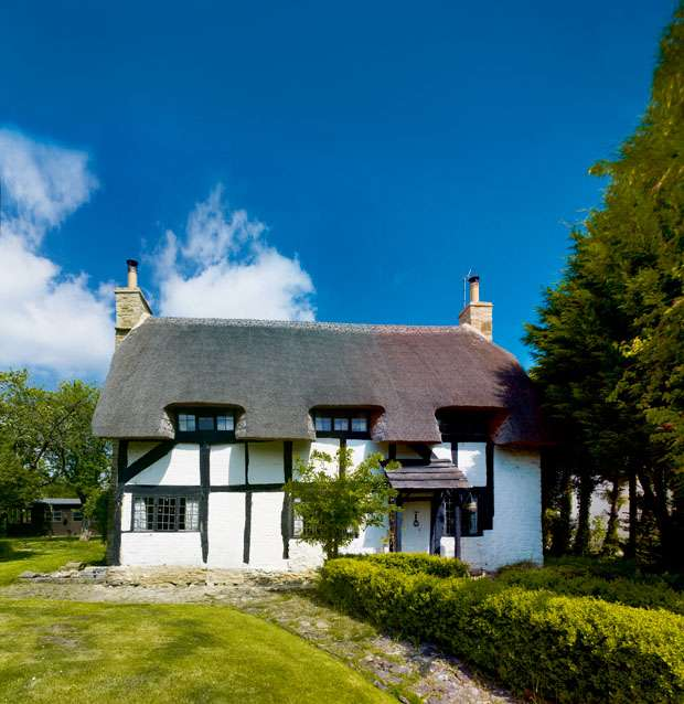 a quintessentially English thatched cottage