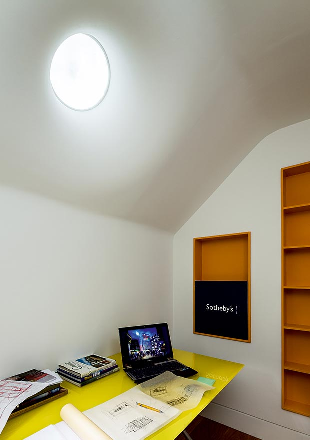 A light pipe brings natural light to a basement office