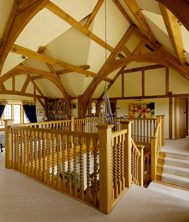 Central stairwell in oak framed country home