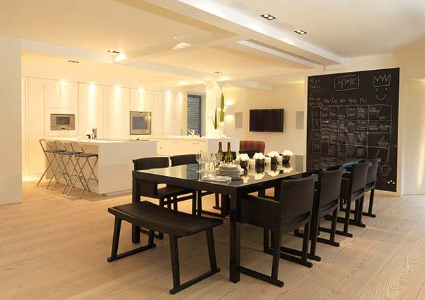 John Cullen lighting scheme to zone a kitchen diner with blackboard wall