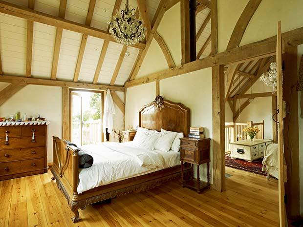 Oak frame home master bedroom with vaulted ceiling