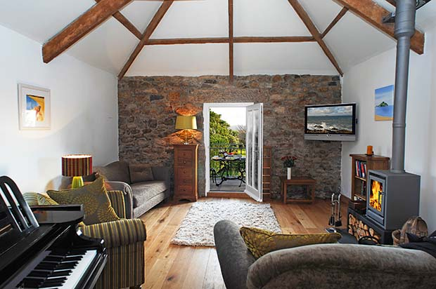 Snug with door to the terrace in a loft conversion in Padstow cornwall with exposed stone walls and beams