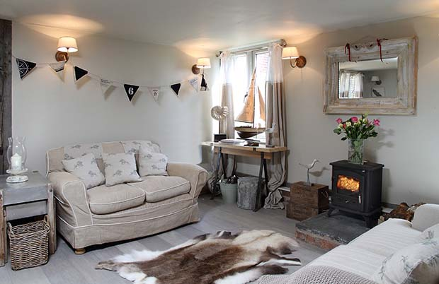 Bunting and pale vintage interiors in Turtledove Hideaway in Whitchurch Shropshire