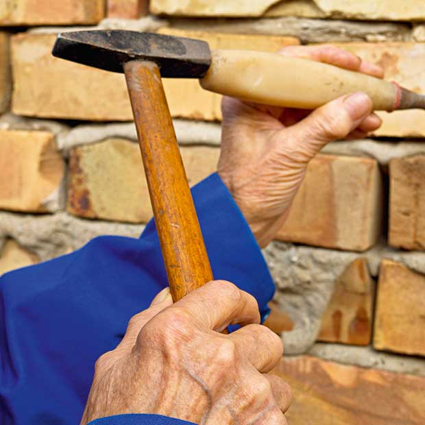 cutting out brickwork may be one way to fix it