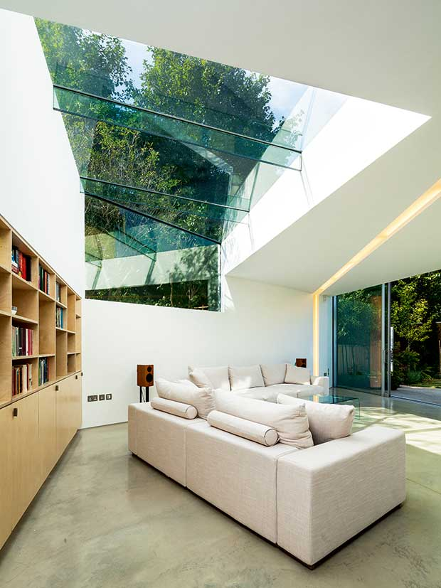 A lounge with large windows and glazed roof to connect it with the outdoors