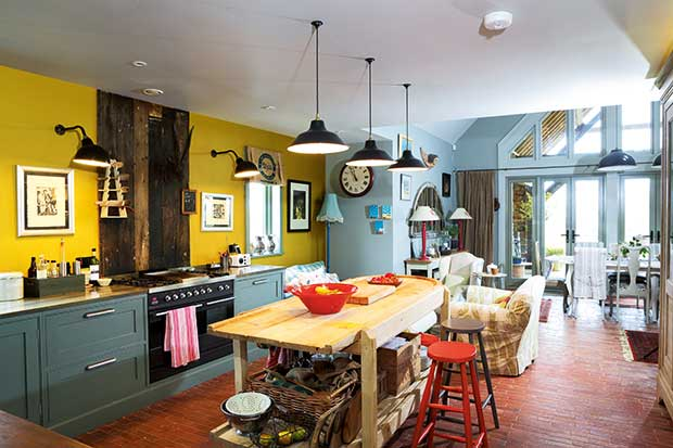 A kitchen living area and kitchen diner with eclectic interior finishes