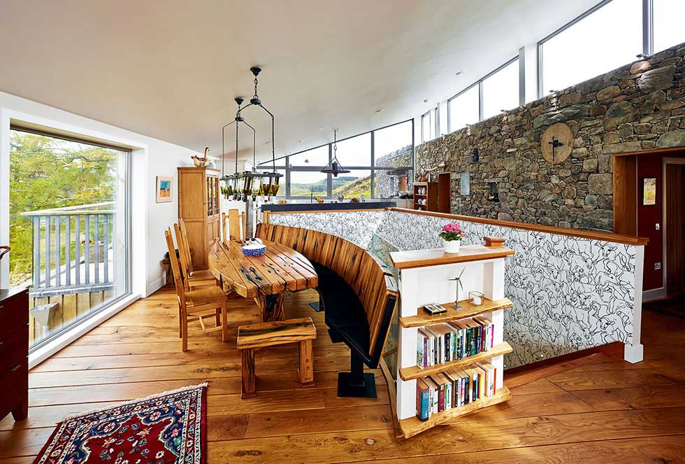 The dining area - the dining table is made of reclaimed railway sleepers