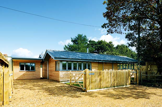 Single storey log cabin in the New Forest clad with Siberian Larch