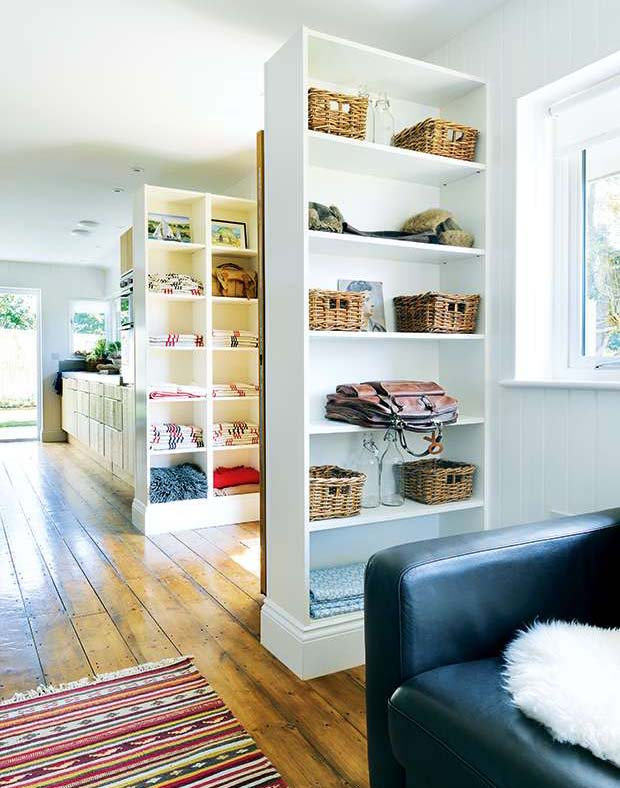 The door sits between customised Ikea Billy bookcases to section off the main living space