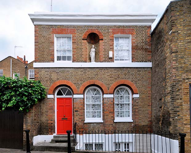 A period property and an adjoining damaged wall