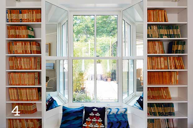 Built in bookshelves to sides of window seat