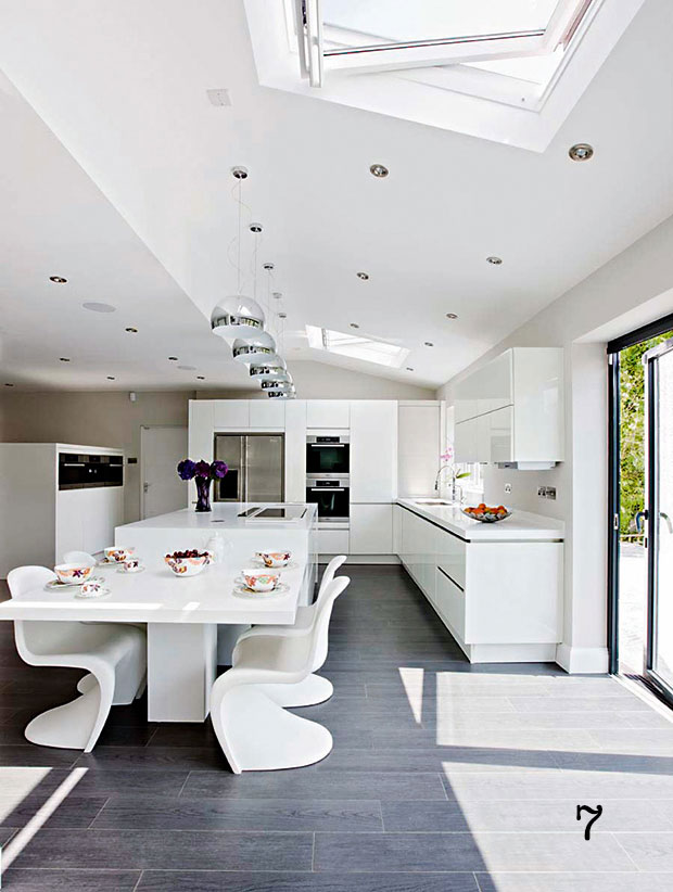 the natural light pouring in through rooflights and bi fold doors