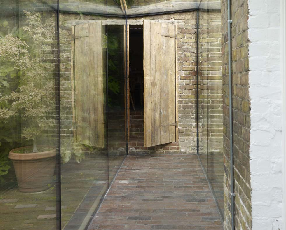 A brick floor in a glazed walkway
