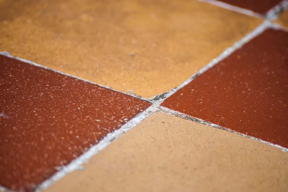 Close up of sealant between floor tiles