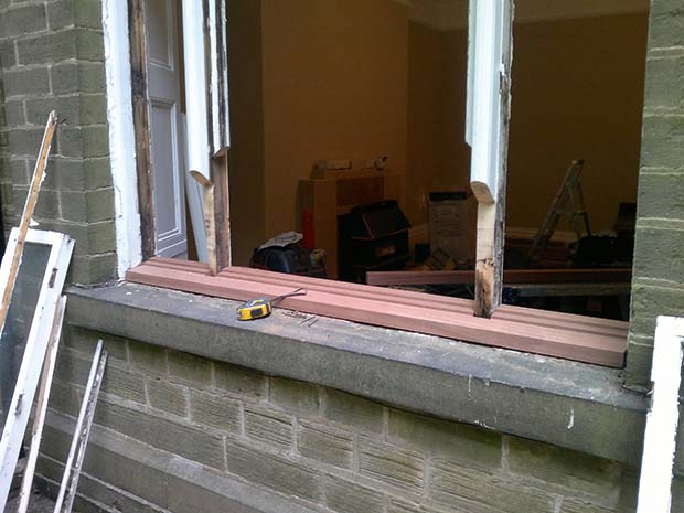 repairing the window frame and cill