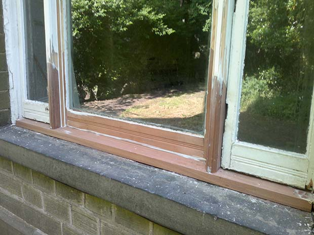 filling gaps in a rotten timber window with epoxy resin