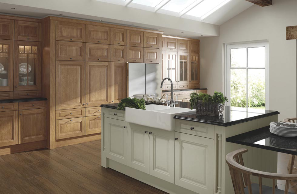 Moving or extending plumbing for a central island should not be an issue when installing a new kitchen. Caple's Chester Oak and Ivory kitchen here costs around £247 for a 600mm base unit