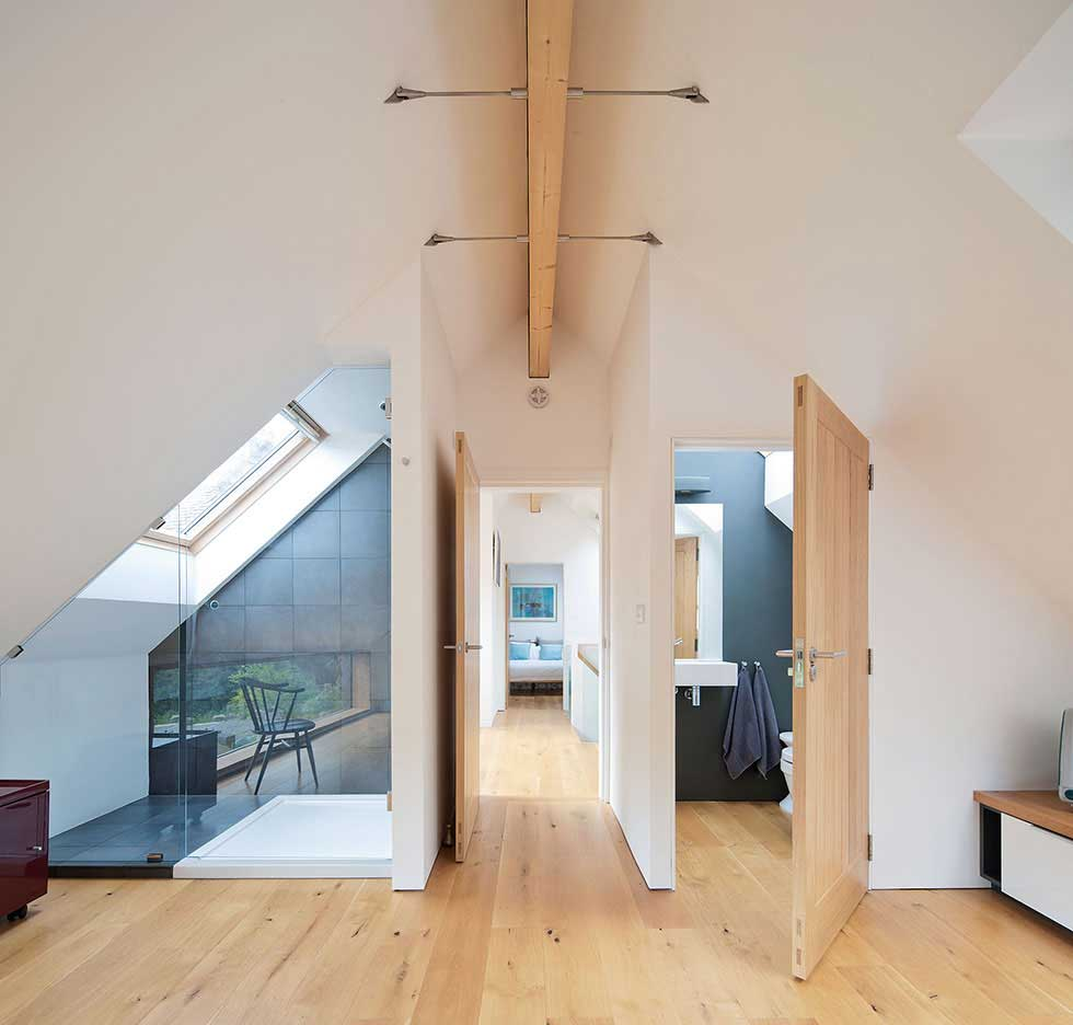 Glulam timber beams provide ample support for the high ceilings