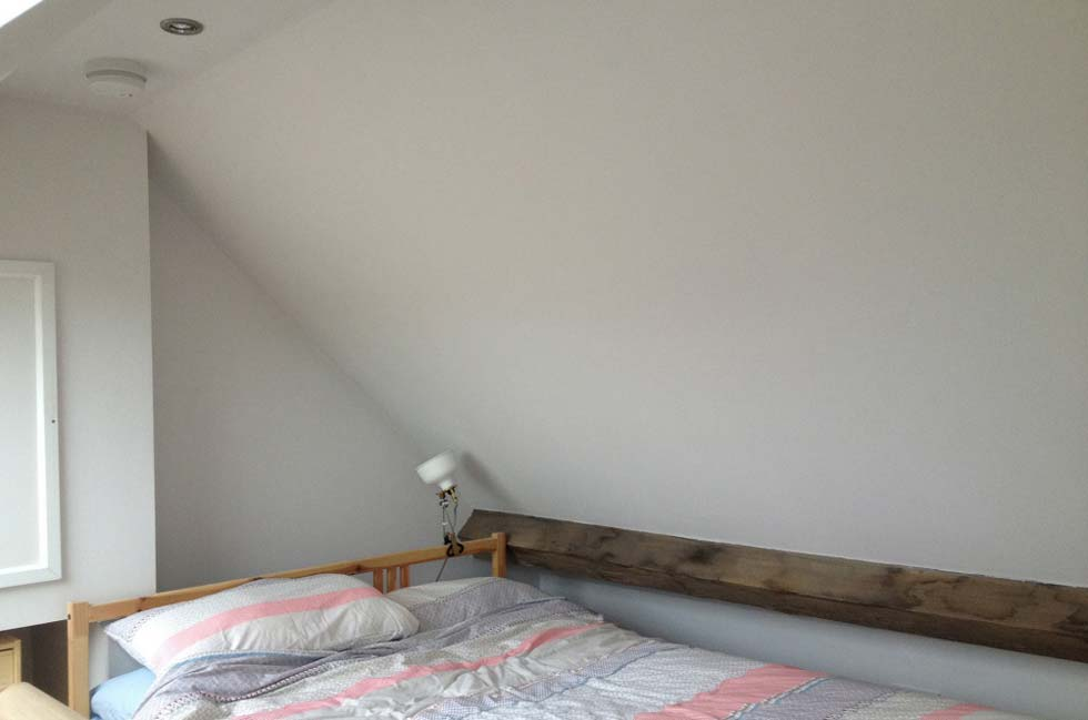 Exposed beam in the loft bedroom