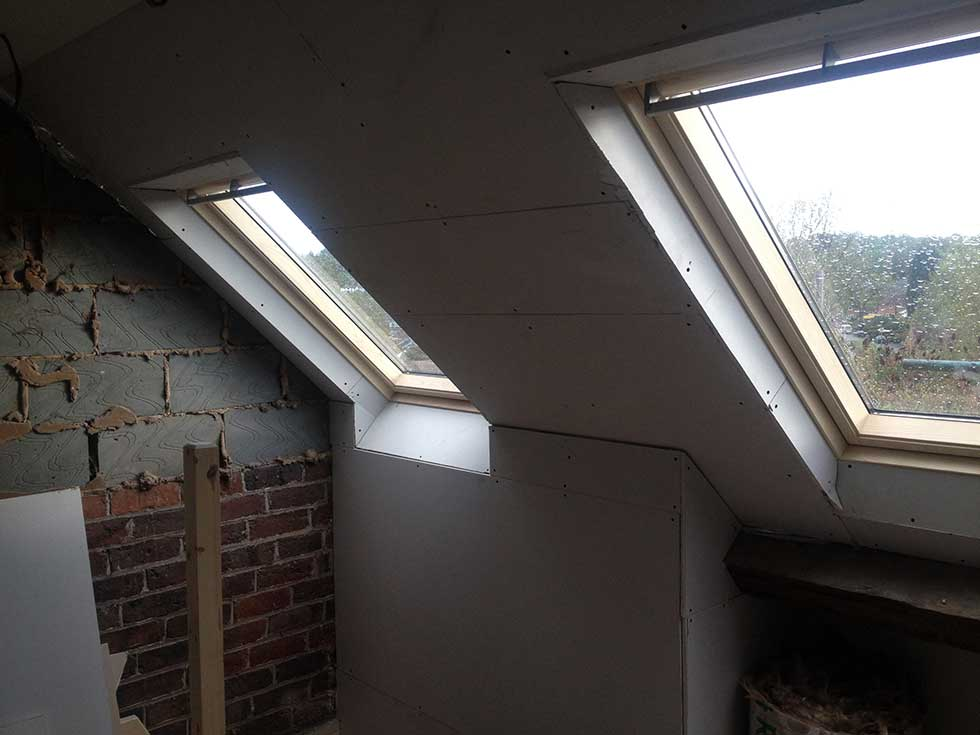 two roof lights and plasterboard room