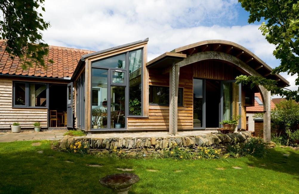 Oak frame home by Carpenter Oak & Woodland