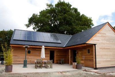 thermal solar panels on a log cabin