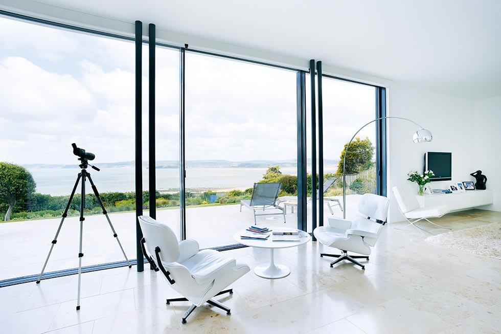 A minimalist lounge with sliding doors
