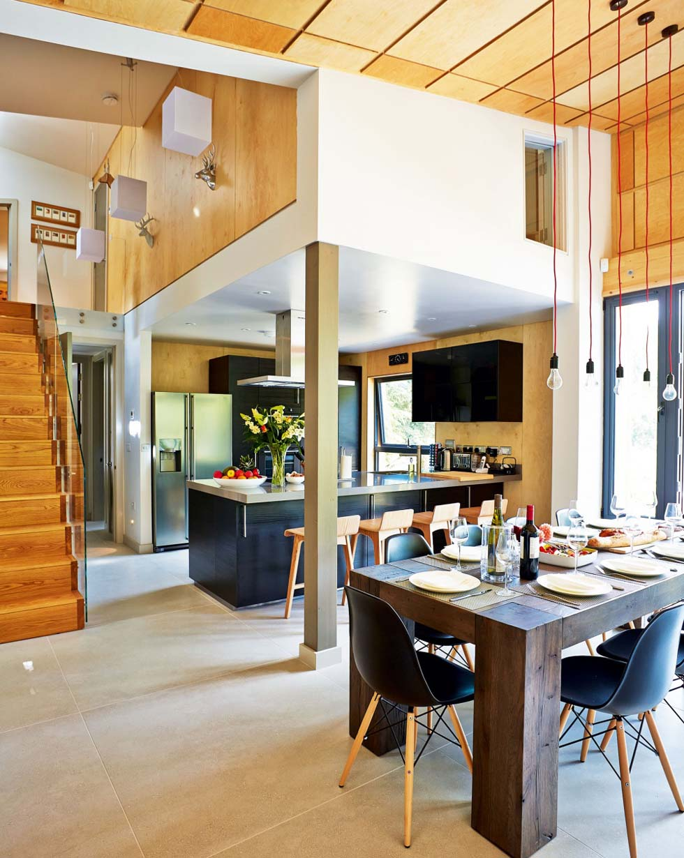The hallway opens into a large room zoned for cooking, eating and relaxing